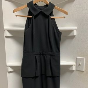classy black midi dress with collar and open back.